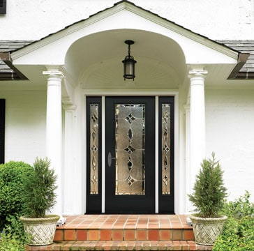 A classic front entrance offers inviting approach and beautiful detailing. Photo: Therma-Tru