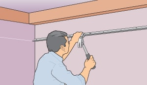 Attach L-shaped support tracks along level line on the walls.