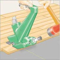 Illustration of a man's hand, hammering a mechanical flooring nailer to secure wood flooring.