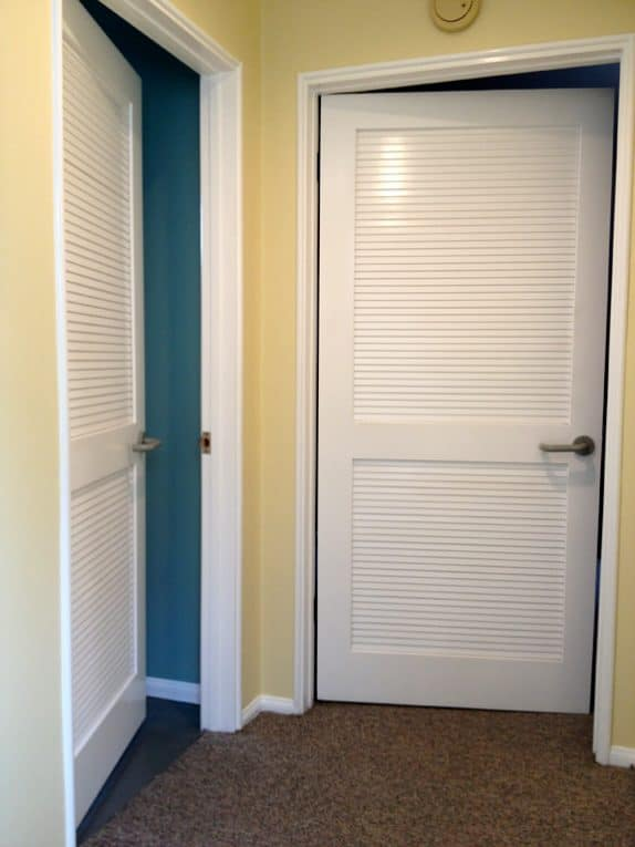 Two rooms with white false louver doors.