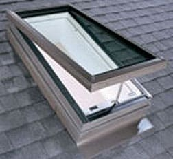A skylight roof window with a manual opening, on a house's ceiling.