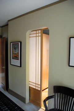 Pocket door with translucent panels glides into the wall for space efficiency. & How to Fix a Pocket Door