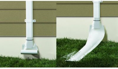 White automatic recoiling downspout attached to a house's drain pipe.