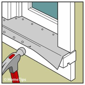 Drawing of a trimmed aluminum sheet nailed underneath a window sill using a hammer.