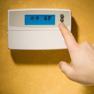 An electronic thermostat offers energy-efficient control.