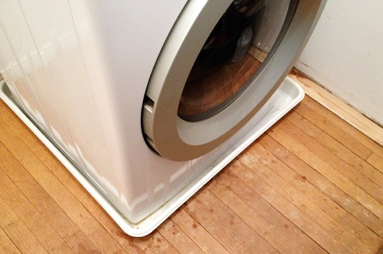 Plastic tray protects the floor if the washing machine has a small leak.