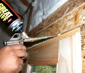 Expanding foam caulk feels large gap between framing and door frame.