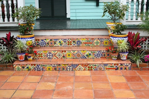 Colorful decorative tiles punctuate the Saltillo pavers on these front stairs.