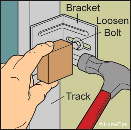 adjust garage door track