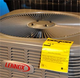 A Lennox air conditioning unit with a yellow EnergyGuide label.