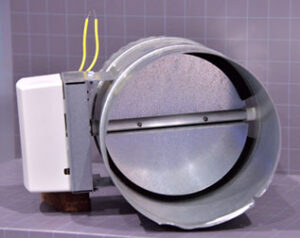 Motorized damper for a zoned system is controlled by small motor to allow the flow of cooled (or heated) air.