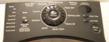 Timer and control buttons of an electric clothes dryer.