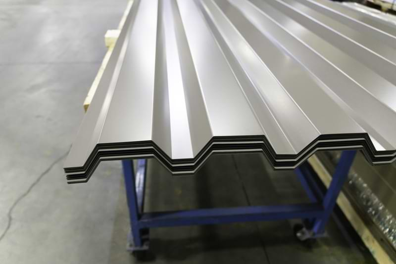 Stacked sheets of metal roofing.