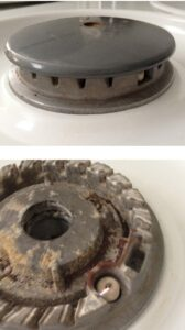 A gas burner with and without cover, including gas ports and an electronic ignition spark.