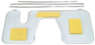 White toilet tank drip tray with yellow sponges in varying shapes.