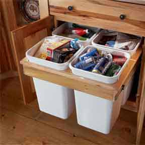 Pull-out trash and recycling bins add utility and space efficiency. Photo: Kraftmaid