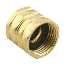 A brass double-female hose coupler on a white background.