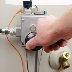adjusting water heater dial