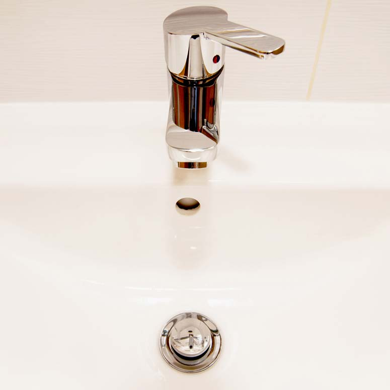 When a sink pop-up drain stopper doesn't work, the solution usually involves a simple adjustment beneath the sink.