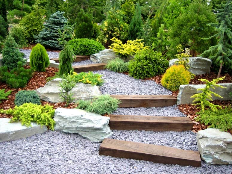 gravel garden pathway with beams