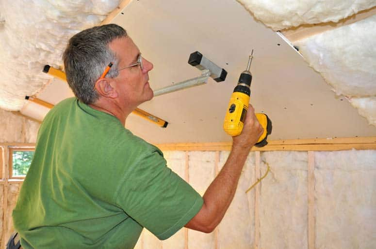 Use drywall screws to fasten sheets to ceiling joists.