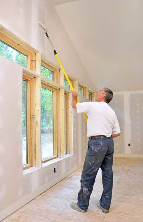 New drywall requires a primer. Use a roller to prime the ceiling first, and then the walls.