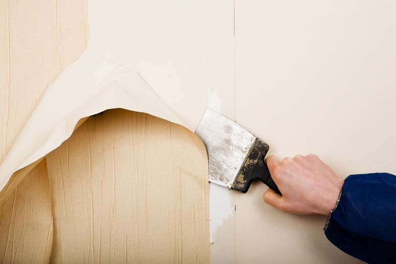 A flat scraper can do an effective job of removing certain types of wallpaper.
