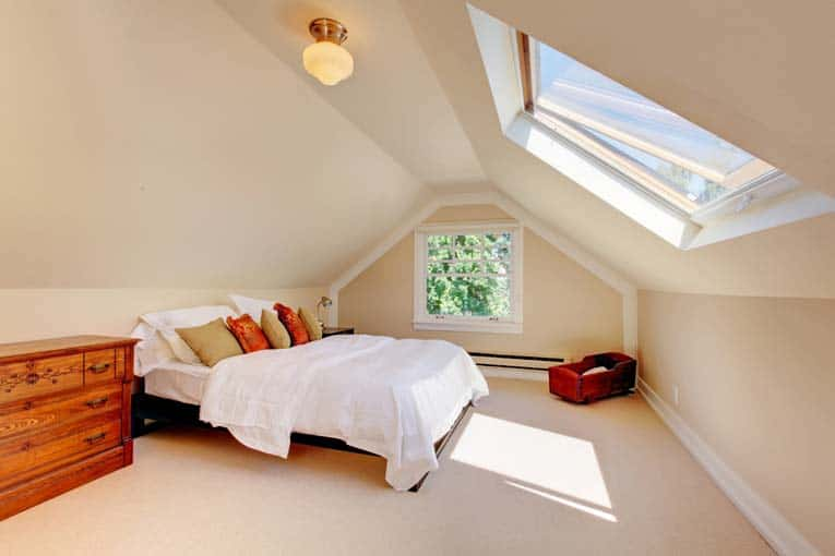 Operable skylight can be opened for generous ventilation. In an attic room like this, a hand-operated latch is easy to use.
