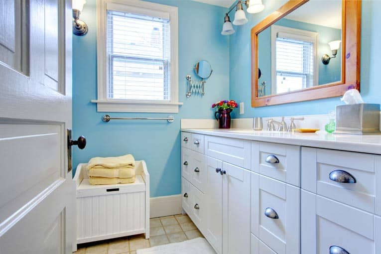 white painted cabinets in bathroom