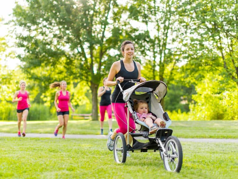 Tricycle-style strollers with large wheels make jogging fun for baby and mom (or dad) alike.