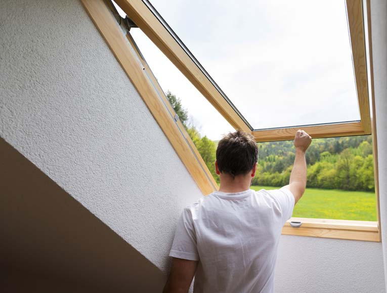Roof windows and skylights in finished attic rooms can be operated manually.