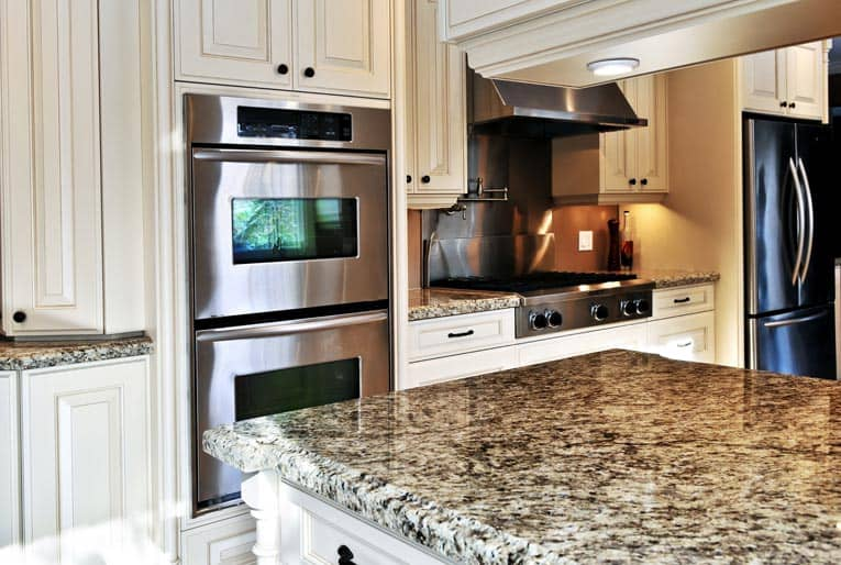 Built In Double Ovens Are Complimented By A Drop Gas Range