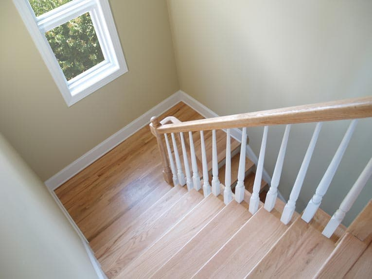 Hardwood stairs with a landing provide for safe, easy movement from one level to another.