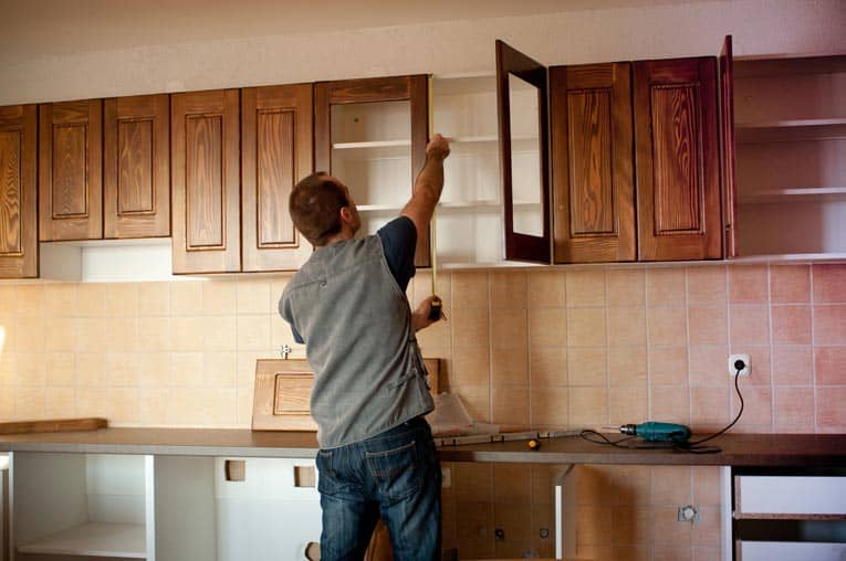 When installing kitchen cabinets, start with the upper cabinets, and then install the base cabinets.