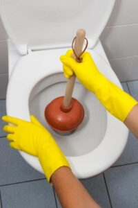 When plunging a toilet, seat a bell-shaped plunger over the drain hole.