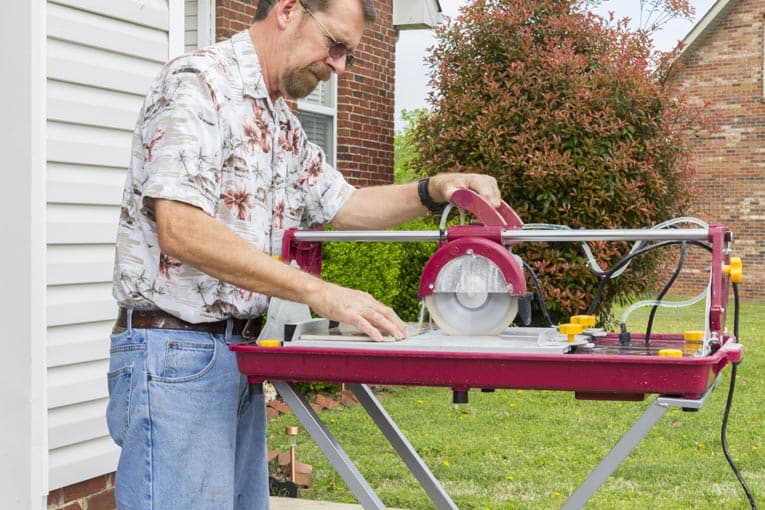 Radial-arm wet saw is easy to use for making straight cuts across ceramic tile.