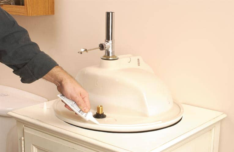 apply sealant around the rim of the sink - Install Bathroom Sink