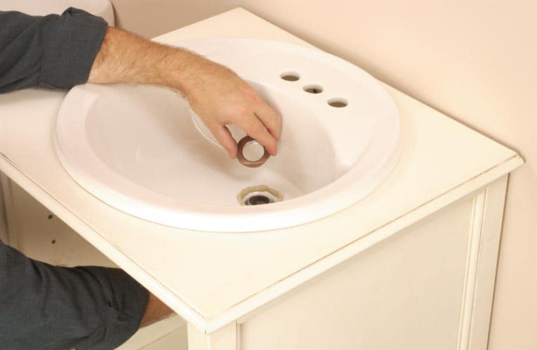 seal the drain assembly and tail piece - Install Bathroom Sink