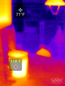 A thermal camera view including a temperature display in two different areas.