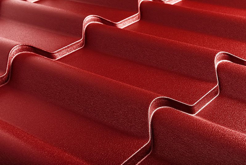 Closeup of textured red metal roofing.