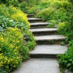 Smooth-cut flagstone stairs leading through a lush garden.